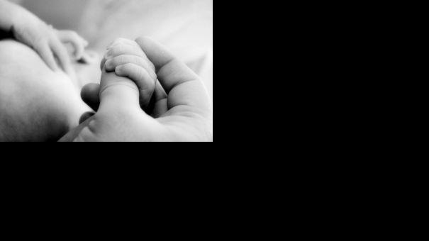 1111673_little_baby_hands_with_mom_and_dads_hands_3.jpg